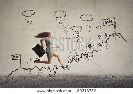 Businesswoman running to reach her goals