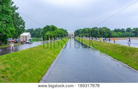 RUSSIA Peterhof - JULY 17 2013. The Grand Canal with fountain mascarons in the lower park and the Grand Palace