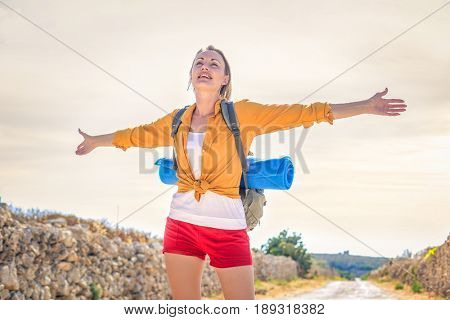 Satisfied young woman on an excursion