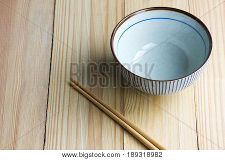 japanese Bowl and chopsticks on the wooden table