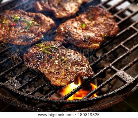 Grilled pork neck steak. Roast pork while grilling