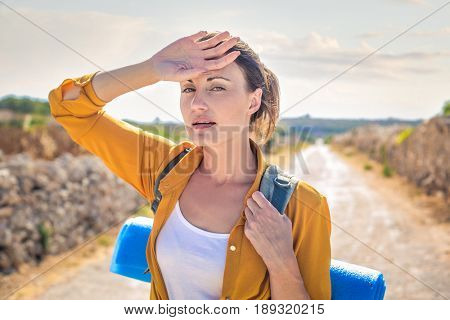 Tired woman on an excursion