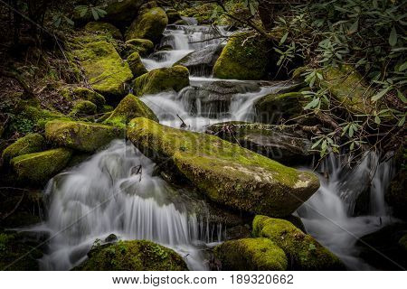 Mossy Boulders With Rushing Water