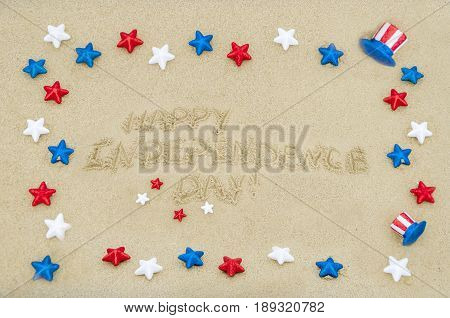 Independence USA background with stars on the sandy beach near ocean