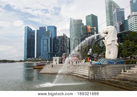 Singapore May 10 2017 : Merlion statue fountain in Singapore city skyline. Merlion fountain is one of the most famous tourist attraction in Singapore.