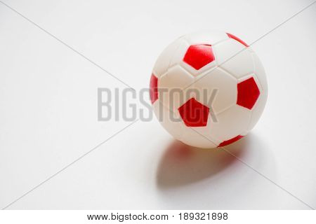Football child toy placed on white background