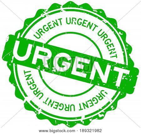 Grunge green urgent round rubber seal stamp on white background
