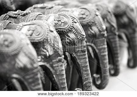 Elephant statues in a row in monochrome