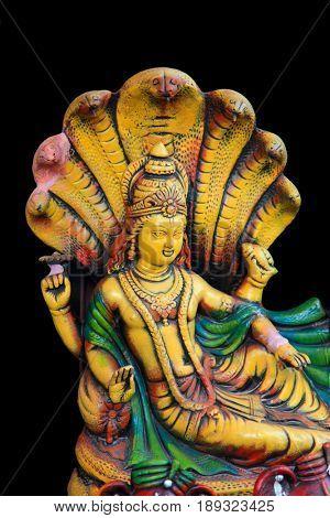 Lord Vishnu statue isolated on black background