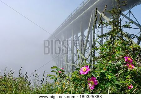 Deception Pass Bridge in fog. Arch bridge. Decetion Pass State Park. Puget Sound. Juan de Fuca Strait. Whidbey Island. Seattle. Washington. United States.