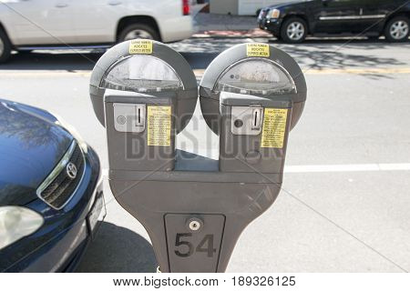 Parking meter costs twenty five cents for two hours of parking in a village on long island.