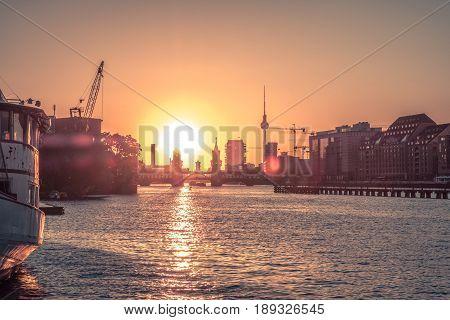 River Spree Oberbaum Bridge Tv Tower - Berlin city skyline with sunset sky