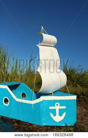 The Handmade ship with a white sail