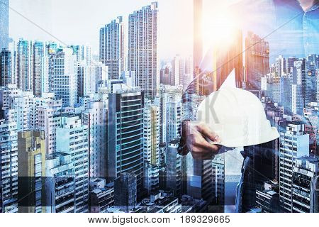 Architect Man Working Hold Engineer Helmet, Engineer Inspection In Workplace For Architectural Plan,