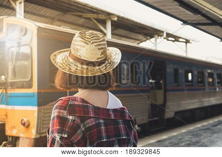 Enjoying Travel. Young Pretty Woman Traveling And Classic Train. Alone Travel Concept. Vintage Filte
