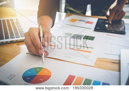 Business Man Hands At Working With Financial Plan And Calculator On Wooden Desk In Office, Group Sup