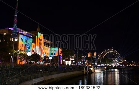 Sydney Australia - May 30 2017. Harbour Bridge and Museum of Contemporary Art (MCA) from Circular Quay during Vivid Light Festival. Harbour Bridge is one of the most famous landmarks in Sydney.