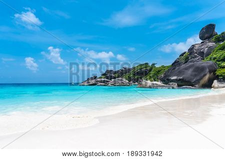 Beautiful view with blue sky and clouds blue sea and white sand beach on Similan island No.8 at Similan national park Phuket Thailand is most popular vacation for tourist.