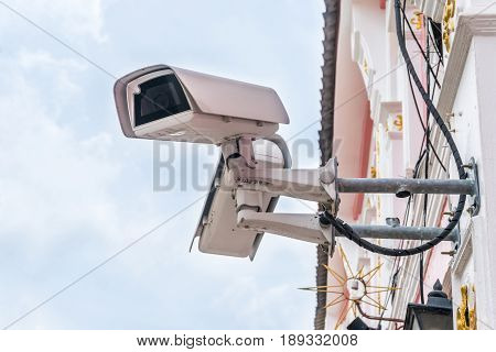 Closed Circuit Television camera isolated on white building background. Selective Focus
