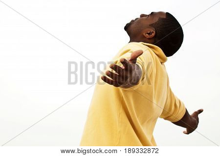 African American man with open ams. Worship.