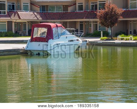 Private boat moored near luxury condo building