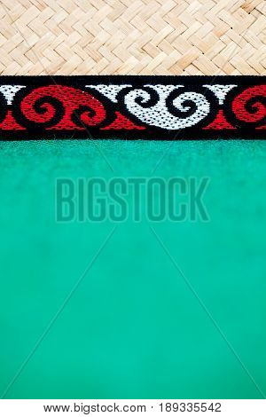 New Zealand - Maori theme - tribal design with flax and green burlap background