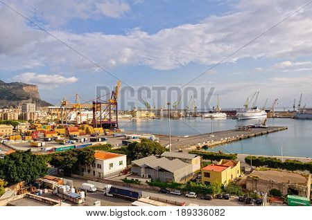 Ships, cranes, containers and trucks at Poret of Palermo Molo Piave - Palermo, Sicily, Italy, 21 October 2011