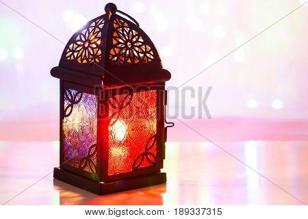 Arabic lantern in colorful background. Ramadan, Eid concept