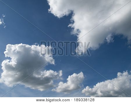 Dramatic clouds against a blue sky background