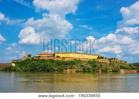 NOVI SAD SERBIA - MAY 15 2017: Petrovaradin Fortress is a fortress in the town of Petrovaradin part of the City of Novi Sad Serbia. Cornerstone of the fortress was laid on 18 October 1692. Nowdays it is famous as location of music festival EXIT.