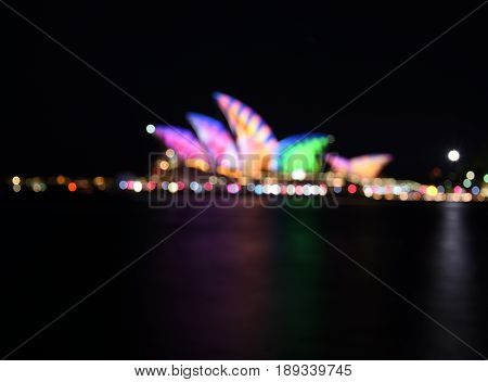 Sydney, Australia - May 30, 2017. Bokeh Night city lights Abstract colorful blurred defocused dot Soft focus. Sydney Opera House illuminated with colourful light design imagery during the Sydney Vivid Lights Festival.