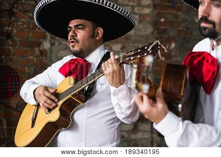 Mexican musicians in the studio, in the interior. Mexico, mariachi, artist, guitarist.