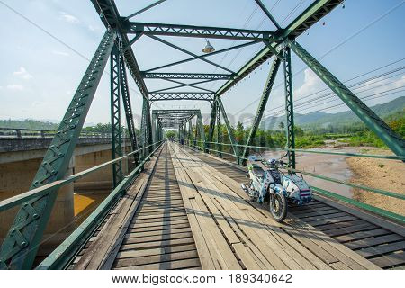 PAI THAILAND - 24 MAY 2017: Old motorcycle on the Memorial Bridge in Pai district at Mae Hong Son province, Thailand.