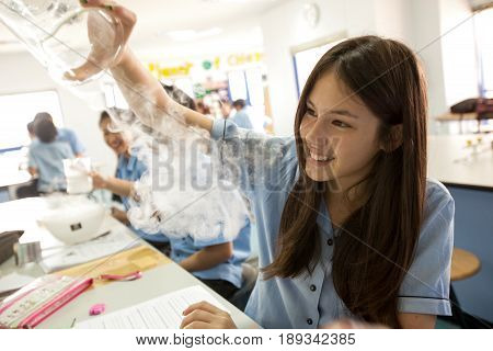 Students In Science Class, Studying The Reaction Of Dry Ice