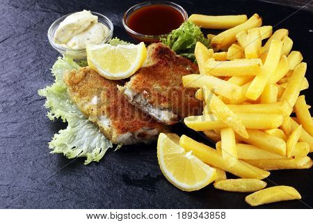 traditional British fish and chips with lemon