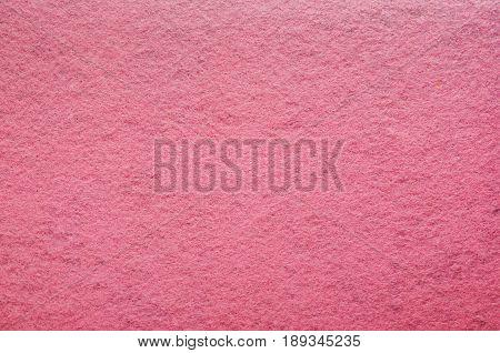 Pink Felt Texture Background. Fiber texture of felt close-up