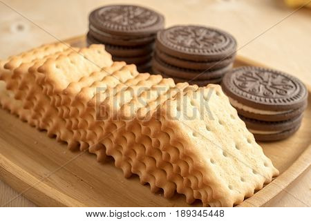 Bunch of cracker on a wooden plate