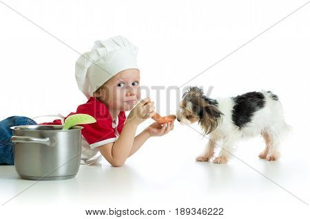 Role-playing game. Child boy playing chef with his dog.