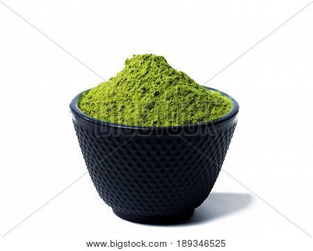 green matcha tea powder in black bowl isolated on white background poster