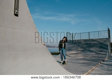 Awesome Skateboarder Girl With Skateboard Outdoor At Skatepark. Skatebord At City, Street. Cool, Fun