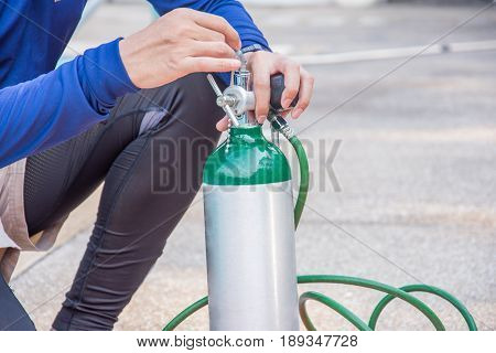 man use oxygen cylinder equipment for helpcare treatment