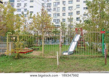 Nizhny Novgorod Russia. - October 13.2016. Children's playground is fenced with a fence with a locked gate. Only for the children of the residents of the neighboring house.
