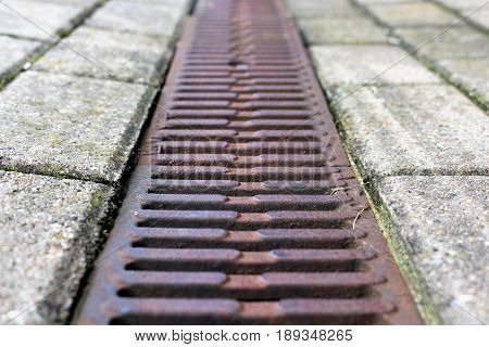 An Image of a drain - Drainage, street poster