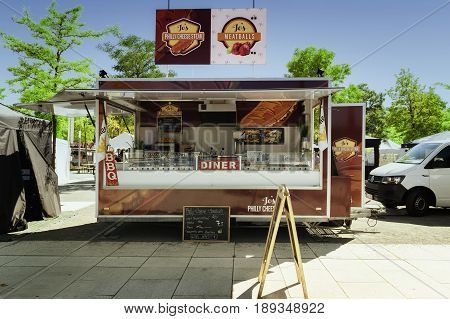 SCHWERIN GERMANY JUNE 2 2017: Mobile kitchen in a food truck selling bbc steaks and meatballs during the international street food festival weekend in the city