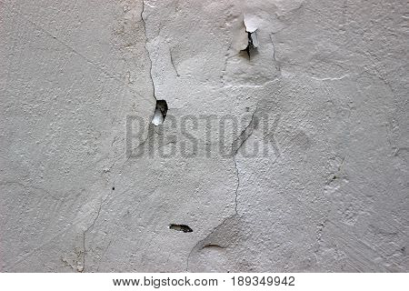 White urban background grunge wall texture, peeling paint and brick wal