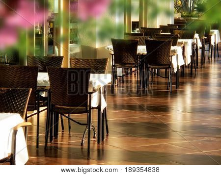 close up shot of outdoor empty restaurant table and chairs.