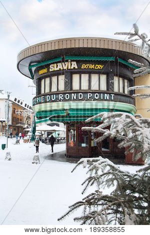 Chamonix, France - January , 30, 2015: Bar and street view at square in ski resort in French Alps