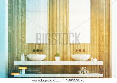 Wooden bathroom with a light wall two white sinks and two tall rectangular mirrors hanging above them. 3d rendering toned image