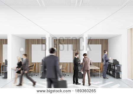 People in an office with white and wooden walls and diamond floor pattern. There are blank vertical pictures in each of them a desk with a computer a chair and shelves. 3d rendering mock up