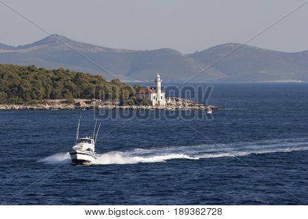 Fast boat sails near coast of Brac island